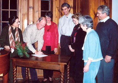 Founding Board of Directors sign the FOSC bylaws and articles of incorporation, Jan 2002.