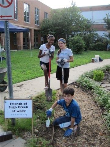Student volunteers establishing a native plant garden