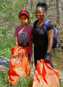 Mother and daughter at a sweep the creek event