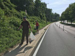Picking up trash along University Boulevard's new bike lanes.