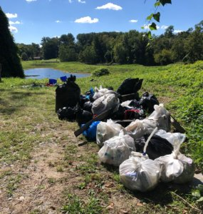 Bags of trash from the Wheaton stormwater ponds at the Fall Sweep the Creek 2021